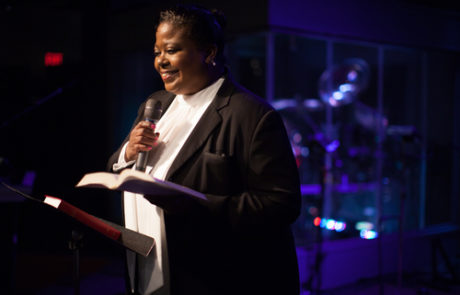 Woman Pastor Preaching from the Bible